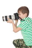 Boy holding a camera — Stock Photo