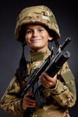 Young soldier with rifle — Stockfoto
