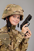 Young boy dressed like a soldier with a gun — Foto de Stock