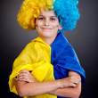 Football fan with  ukrainian flag on a black background - Stockfoto
