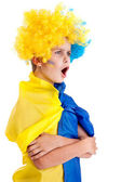 Football fan with ukrainian flag on a white background — Photo