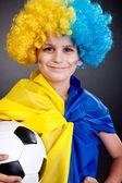 Football fan with ukrainian flag on a black background — Stock Photo