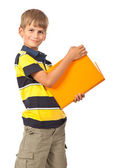 School boy is holding a book — Stock Photo