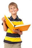 Szkole chłopiec trzyma książkę — Zdjęcie stockowe