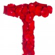 Letter T made from red petals rose on white — Stock Photo #11963577