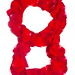 Number 8 made from red petals rose on white - Stock Photo