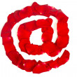 E-mail symbol  made from red petals rose on white — Stock Photo