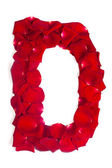 Letter D made from red petals rose on white — Stock fotografie