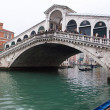 Venice Grand canal with gondolas and Rialto Bridge — Stock Photo #11978146
