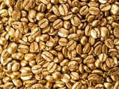 Coffee gold closeup background. — Stock Photo