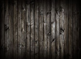 Black wooden planking background. — Stock Photo