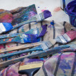 Paintbrushes in a painters studio — Stockfoto