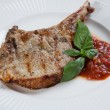 Stock Photo: Pork chops with BBQ sauce