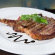 Stok fotoğraf: Grilled Pork chops. Meat on the bone.