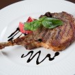 Foto de Stock  : Grilled Pork chops. Meat on the bone.