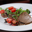 Beef medallions served with balsamic sauce — Stock Photo