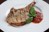 Pork chops with BBQ sauce — Stok fotoğraf