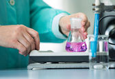Flask in a pharmacology laboratory — Stock Photo
