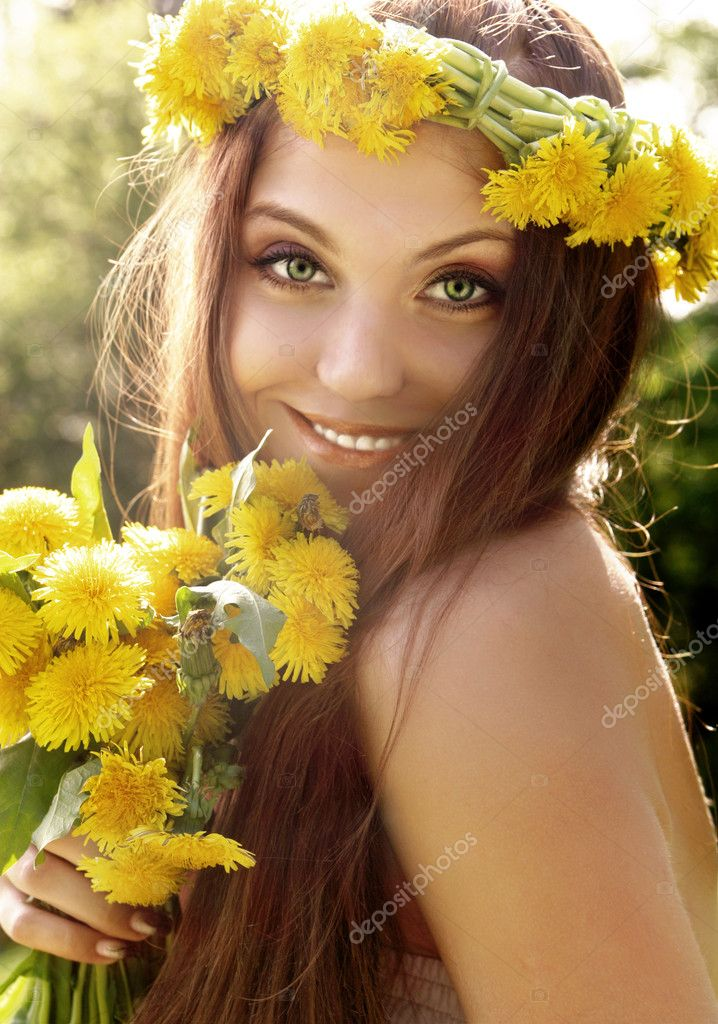 Attractive young summer girl with flowers — Stock Photo #10980698