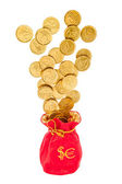 Sack with euro and dollars coins — Stockfoto