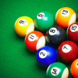 Billiard balls on green cloth — Stock Photo