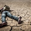 Person lays on the dried ground — Stock Photo #11796170