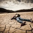 Person lays on dried ground — Stock Photo #12029192