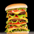 Tasty and appetizing hamburger on a dark — Stock Photo #12029201
