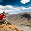 Photographer on the high mountain — Foto Stock