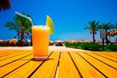 Tasty juice with melon opposite the beach — Stock Photo