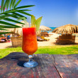 Wonderful goblet of cocktail opposite exotic beach. - Stock Photo