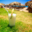 Pina Colada and sunny beach. - Stock Photo
