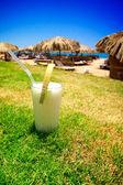 Pina Colada and sunny beach. — Stock Photo