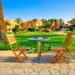 Resort and small lawn with chairs  early morning. - Stock Photo