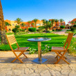 Resort and small lawn with chairs early morning. — Stock Photo #11390416