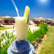 Pina Colada,blue sun and sunny beach. - Stock Photo