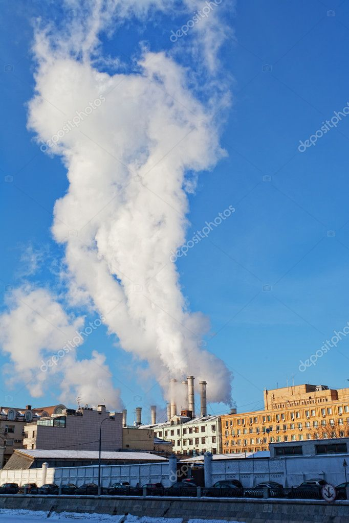 Steam goes from thermal power plant pipes in the large city.  Stock Photo #10929424