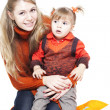 Mother and the daughter in bright orange clothes — Stock Photo