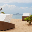 Стоковое фото: Canopies from sun on beach in tropics