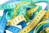 Yellow, green and dark blue measuring tapes — Stock Photo