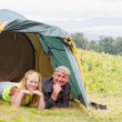 Stock Photo: Happy pair in tent against mountains