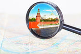 Tourist map and lens, as concept of travel — Stock Photo