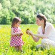 Young mother with the small daughter on summer walk — Stock Photo