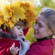 Happy mother with the daughter walk in autumn park — Stock Photo #11967503