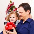 Merry Christmas - little girl with father with Christmas gifts — Stok fotoğraf
