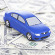 Toy car on money as the concept of purchase and sale of cars - Stock Photo