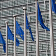 European Union flags against the European Parliament building — Stock Photo