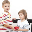 Stock Photo: Boy gives to the girl red apple