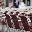 Brown wicker chairs in street cafe - Stock Photo