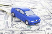 Toy car on money as the concept of purchase and sale of cars — Stock Photo